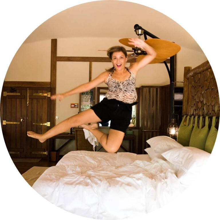 Jumping-in-a-hotel-bed